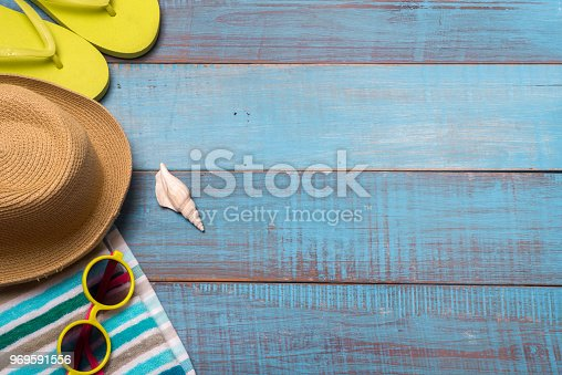 674650538istockphoto Hats, sunglasses, beach shoes, towels on the board 969591556