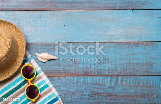 674650538istockphoto Hats, sunglasses, beach shoes, towels on the board 969591572
