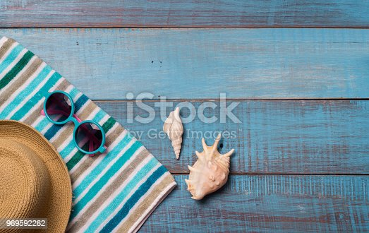 674650538istockphoto Hats, sunglasses, beach shoes, towels on the board 969592262