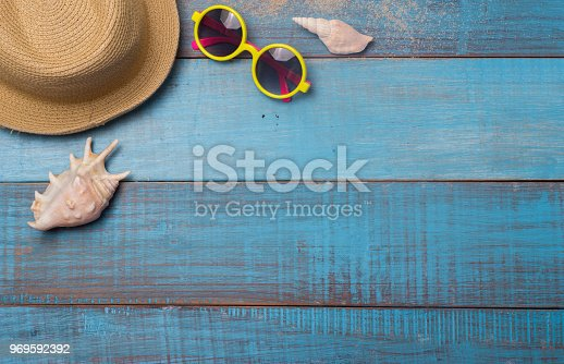 674650538istockphoto Hats, sunglasses, beach shoes, towels on the board 969592392