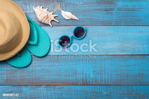 674650538istockphoto Hats, sunglasses, beach shoes, towels on the board 969595142