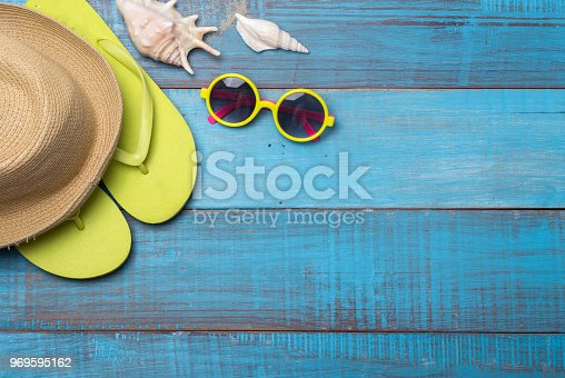 674650538istockphoto Hats, sunglasses, beach shoes, towels on the board 969595162
