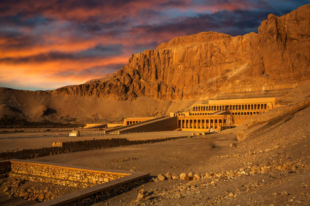 Hatshpsut temple with colorfull sky, Luxor, Egypt Hatshepsut Mortuary Temple in the king's valley valley of the kings stock pictures, royalty-free photos & images