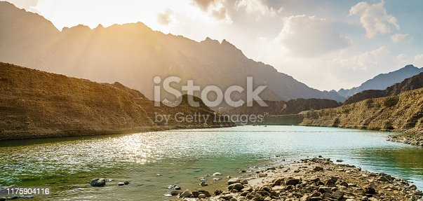 Scenic view of Hatta Lake and Hajar Mountains in the Emirate of Dubai, UAE