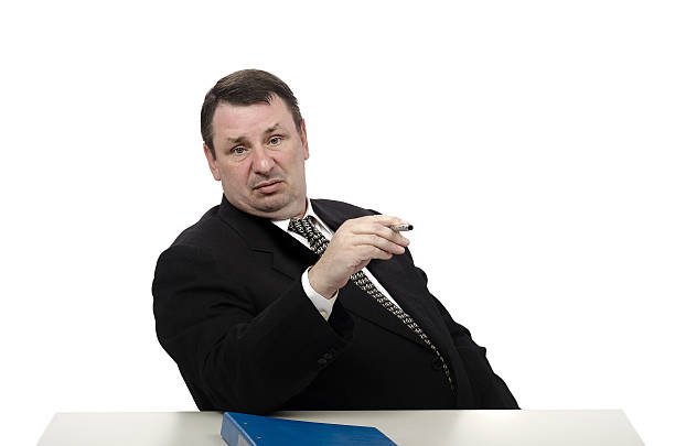 Haughty interviewer looking through Haughty middle-aged recruiter looking straight through the job applicant adversarial stock pictures, royalty-free photos & images