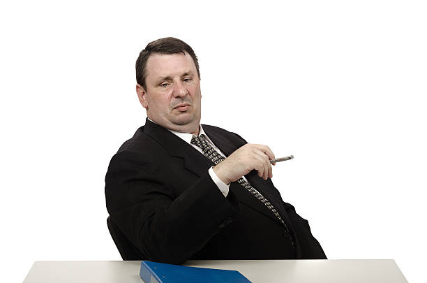 Haughty interviewer staring at jobseeker shoes Middle-aged employer staring at jobseeker shoes in in stress interview adversarial stock pictures, royalty-free photos & images