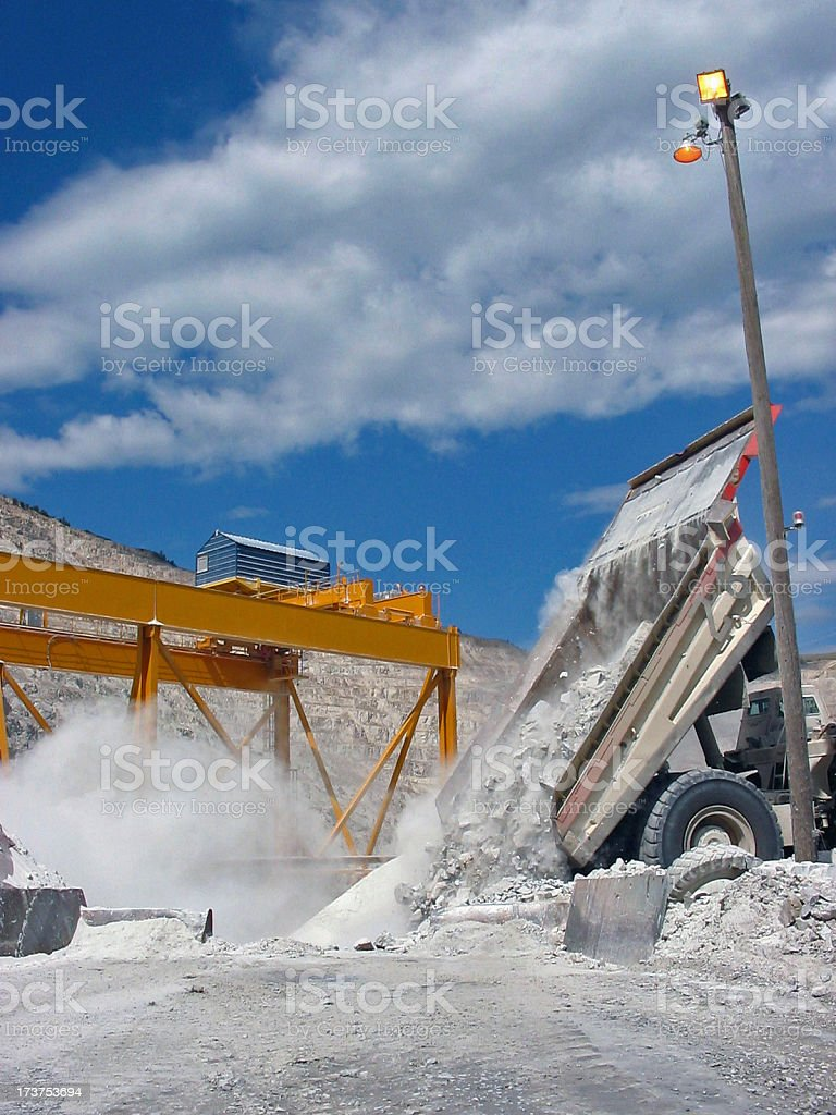 Haul truck dumping into crusher royalty-free stock photo