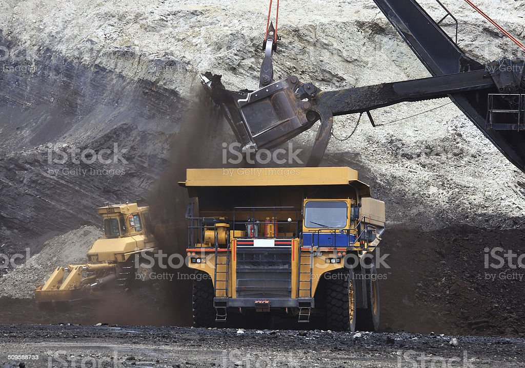 Haul Trucks being loaded with ore. stock photo