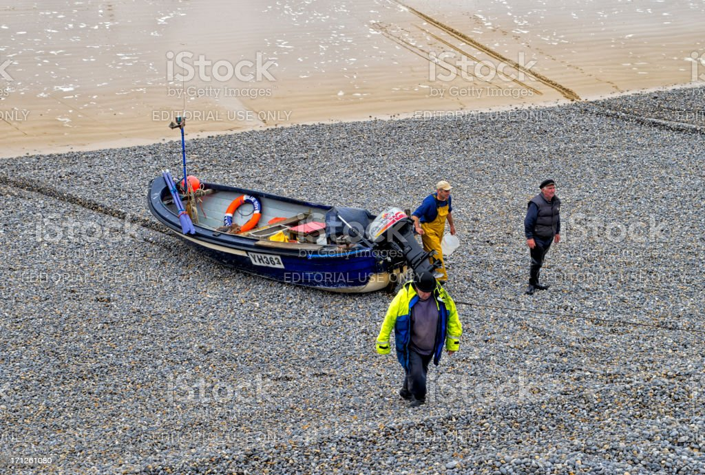 Hauling in a fishing boat royalty-free stock photo