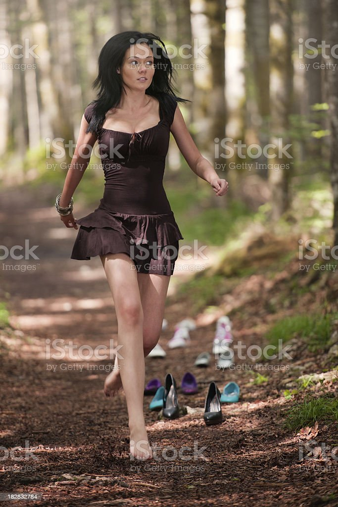 Beautiful woman with long hair running away from her expenses which...