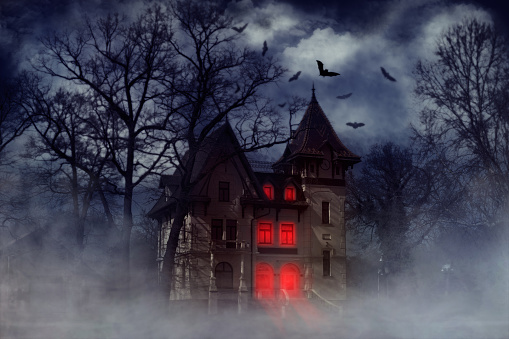 Halloween creepy house with bats and red light from the windows, Halloween theme