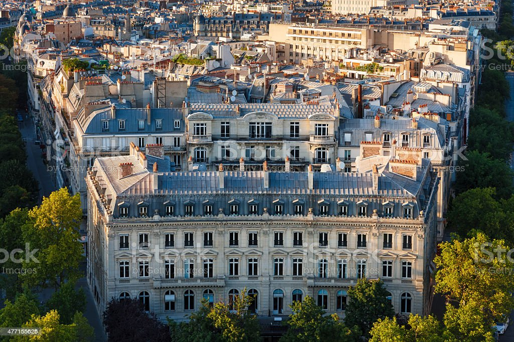 Haussmanian building with curvilinear facade and Paris Rooftops, France stock photo