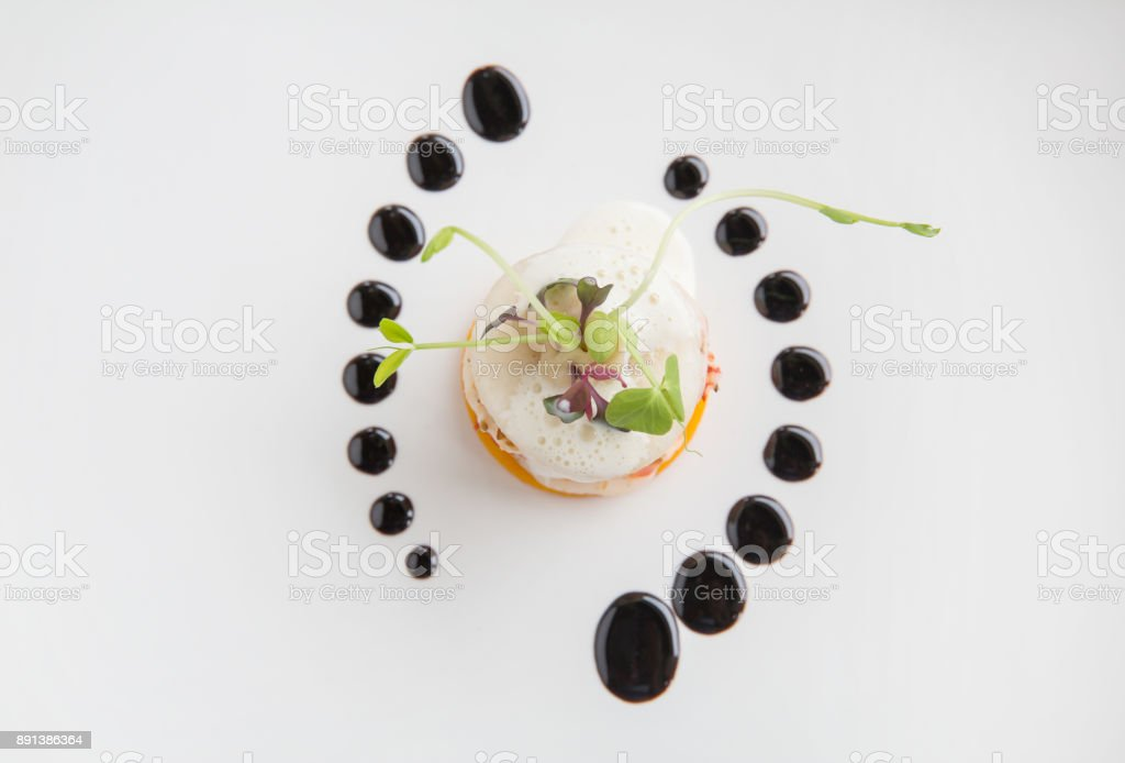Haute high end cuisine gourmet appetizer shrimp, pear, pumpkin with butter foam stock photo