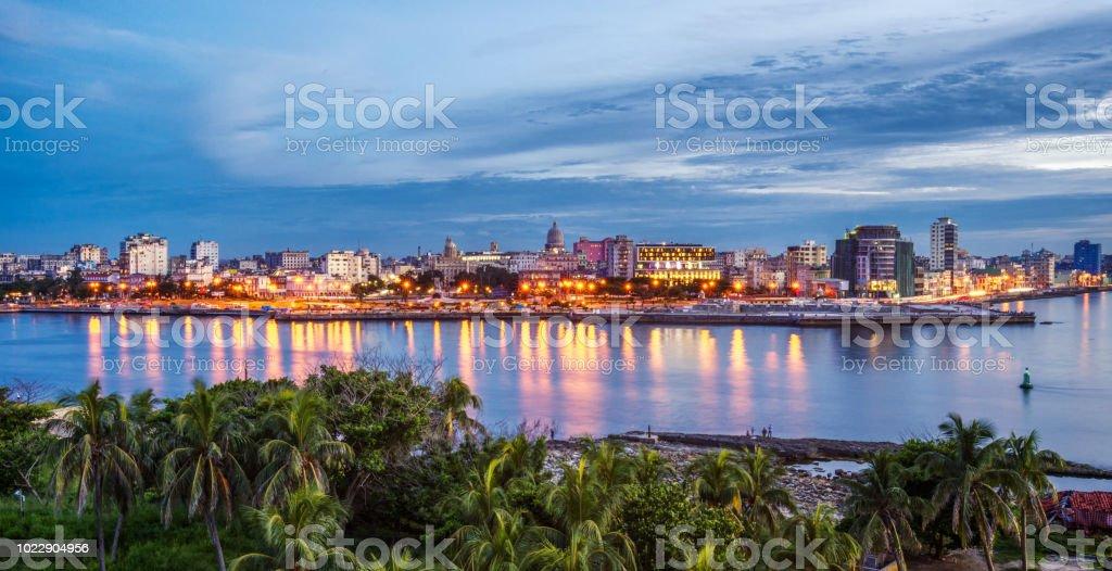 Havana city by sea against sky during sunset. Cuba stock photo