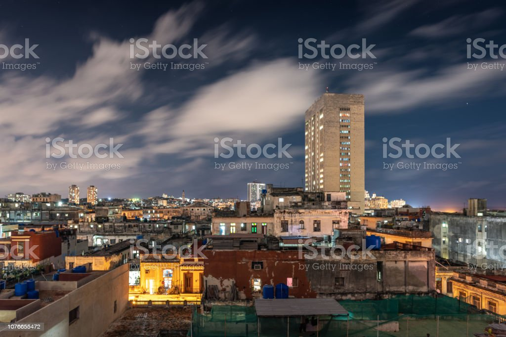 Havana old town skyline and tower block at night stock photo