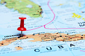 Photo of pinned Havana on a map of North America. May be used as illustration for traveling theme.
