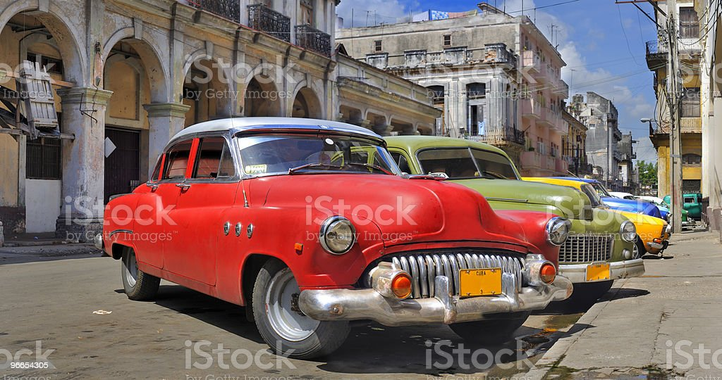 Havana street with colorful old cars in a row royalty-free stock photo