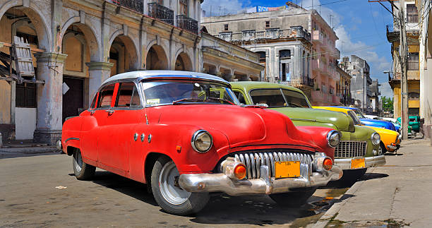 Havana street with colorful old cars in a row stock photo