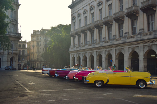 Havana, Cuba, UNESCO World Heritage Site- August 2016: Vintage cars parked in the historic city center at sunrise.