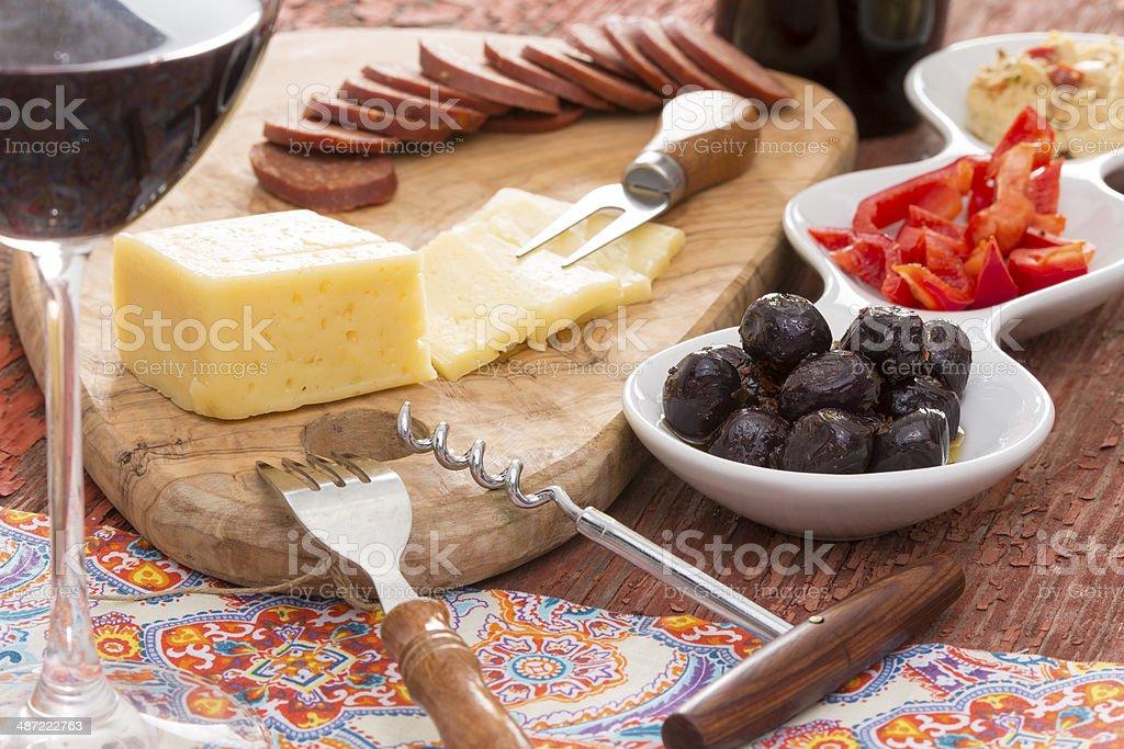 Havarti cheese and savory snacks with red wine stock photo