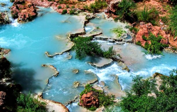Havasupai Falls, pools, blue water, geological formation rock walls Indian Reservation in the top of the Grand Canyon National Park Desert stock photo