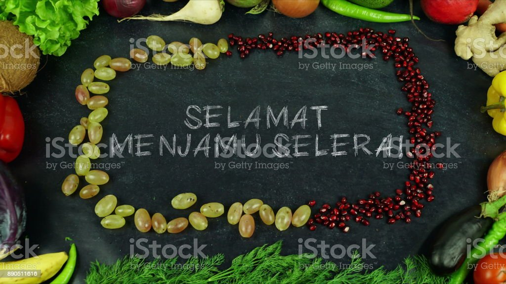Selamat menjamu selera! Malay fruit stop motion, in English Bon appetit stock photo