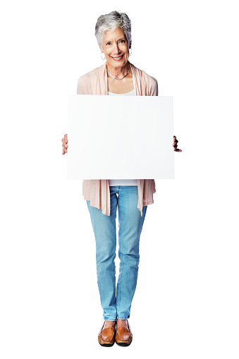 Studio portrait of a happy senior woman holding a blank placard against a white background