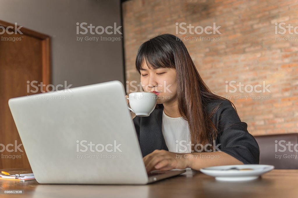 Have a sip of coffee before get back to work stock photo