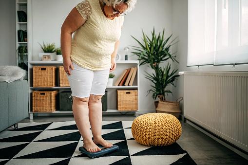 Women measuring her weight