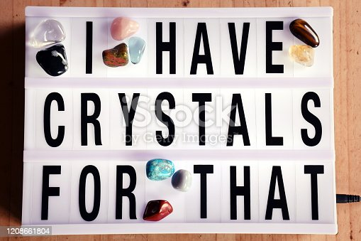 The Phrase - I Have Crystals for That - in Light Box Trend surrounded by a collection of Crystals and Gemstoenes.