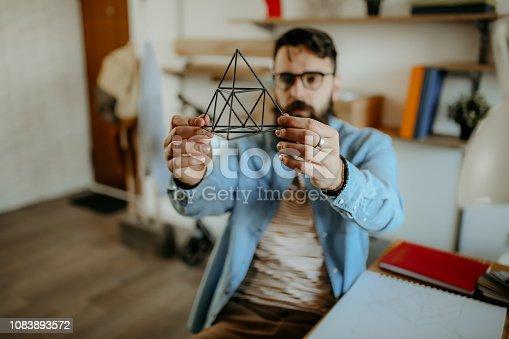 Hipster men examining pyramid for designing full product