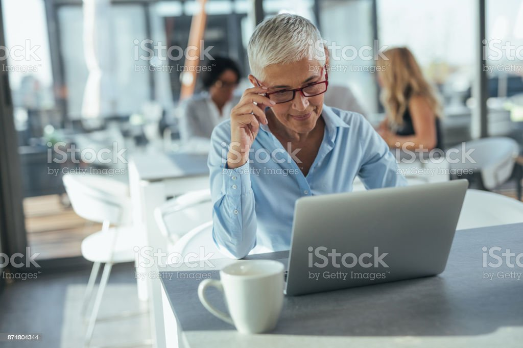 I have the best team behind me Mature businesswoman working on her computer 20-29 Years Stock Photo