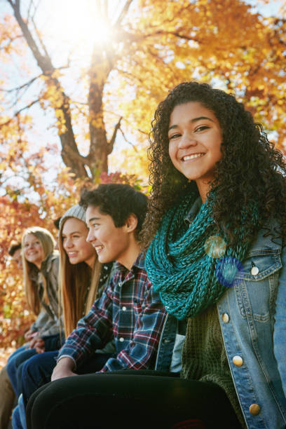 I have the greatest friends in my life Portrait of a group of young friends enjoying a day at the park together teenagers only stock pictures, royalty-free photos & images