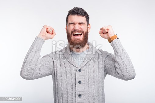 888751614 istock photo I have won. Young man is happy because he's won something. 1203634092