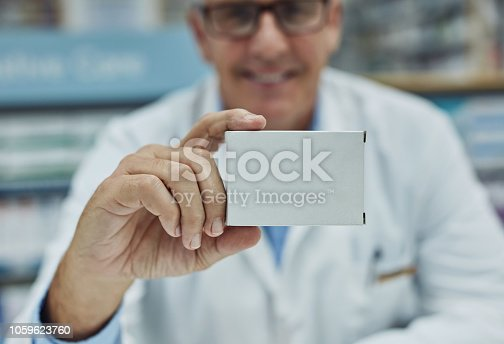 Shot of a mature pharmacist holding a blank medicinal box in a chemist