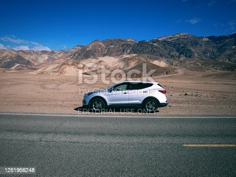 Death Valley road trip - car on side of road in warmest place in the North America