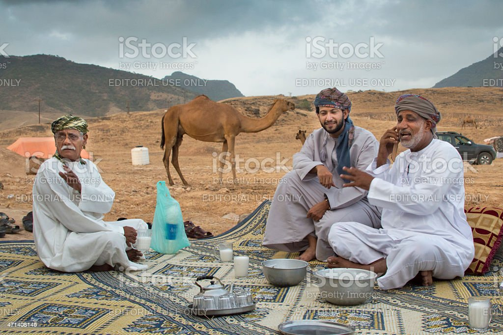 Having a chat in the desert near Salalah, Oman stock photo