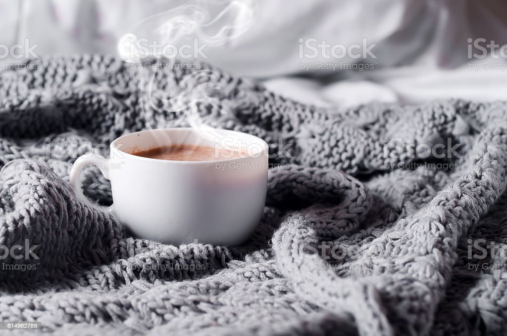 Having a cup of coffee in bed stock photo