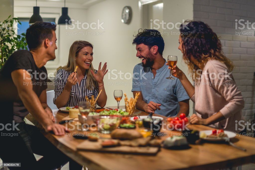 Having a Great time at Dinner party stock photo