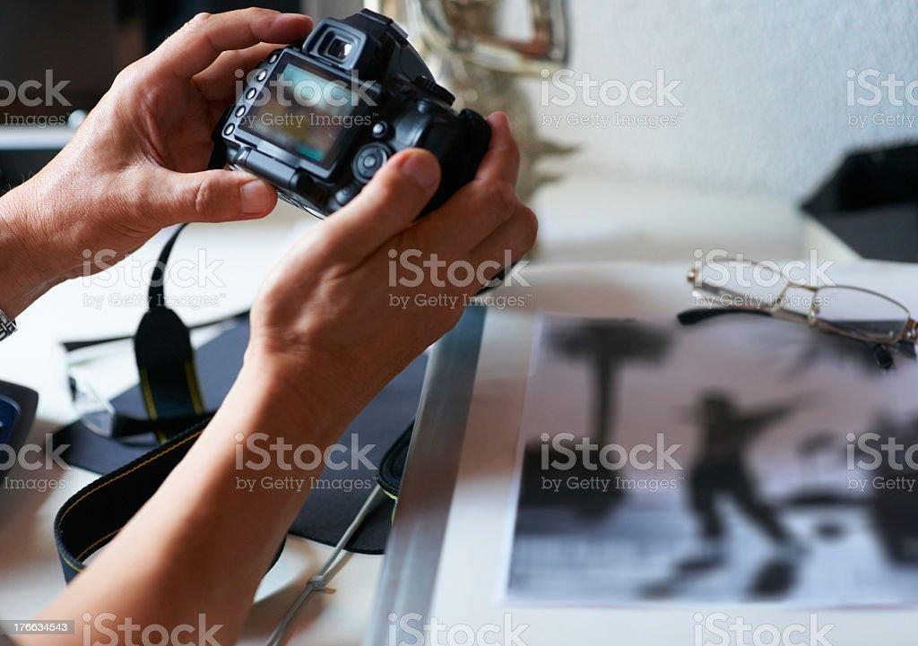 Having a look at his new camera royalty-free stock photo