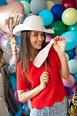 istock Having a lot of fun with party props 1187651071