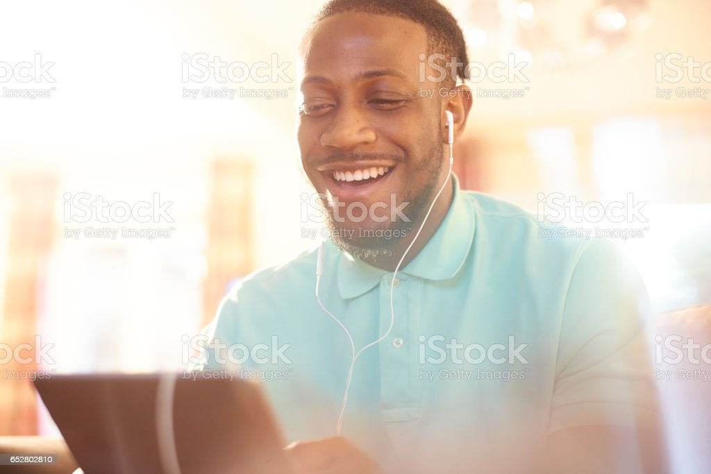 Having a luagh with friends on a video call stock photo