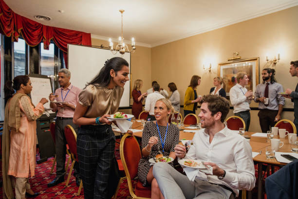 having a lunch break from the conference - office party stock pictures, royalty-free photos & images