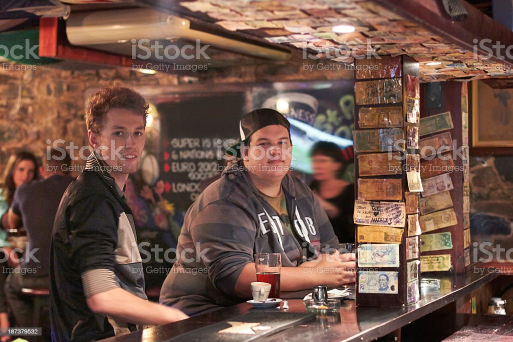 Having a pint with his pal stock photo
