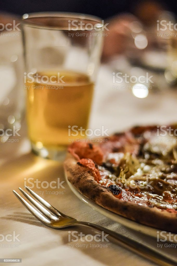 having a pizza and beer close up royalty-free stock photo