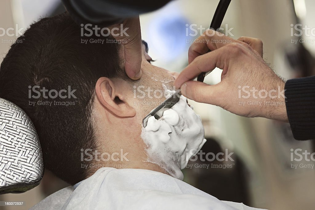 Having a shave at the barbers royalty-free stock photo