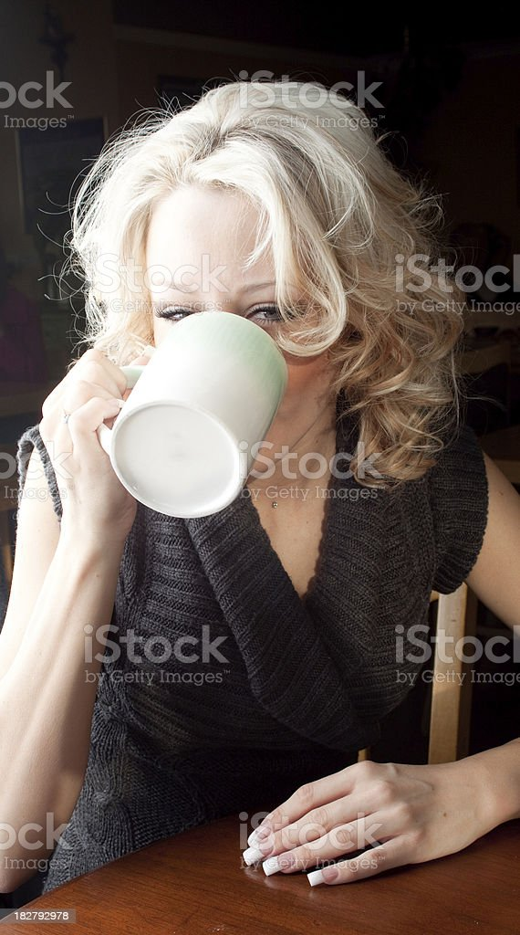 Having a sip of coffee royalty-free stock photo