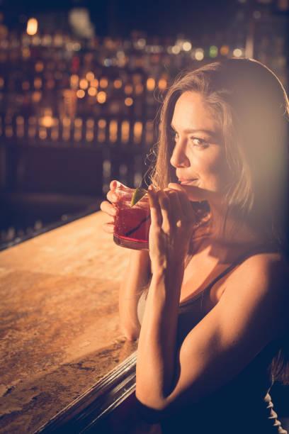 having a sip of my drink - seduzione foto e immagini stock