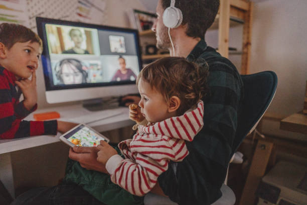 Having a video conference call from home Photo of a man working from home, with his sons as a company, having a video conference call leisure equipment stock pictures, royalty-free photos & images