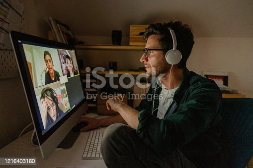 Photo of a man having a video conference call with his colleagues